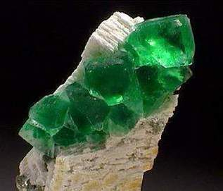 Green precious stones: emerald, demantoid, tourmaline