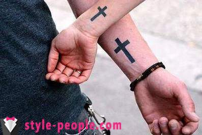 Cross tattoo on his arm. its value